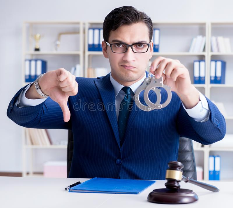 Young lawyer judge sitting in the office. The young lawyer judge sitting in the office royalty free stock photos