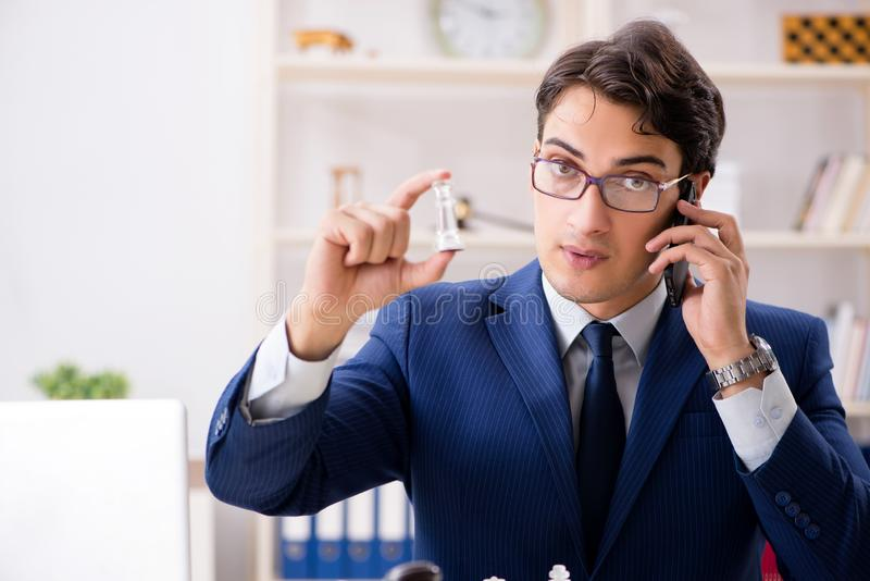 Young lawyer playing chess to train his court strategy and tacti. Cs royalty free stock photos