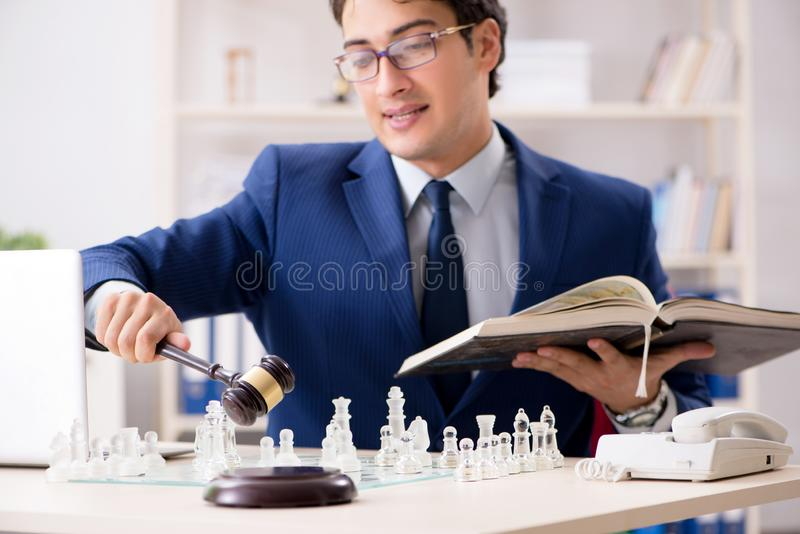 Young lawyer playing chess to train his court strategy and tacti. Cs royalty free stock images