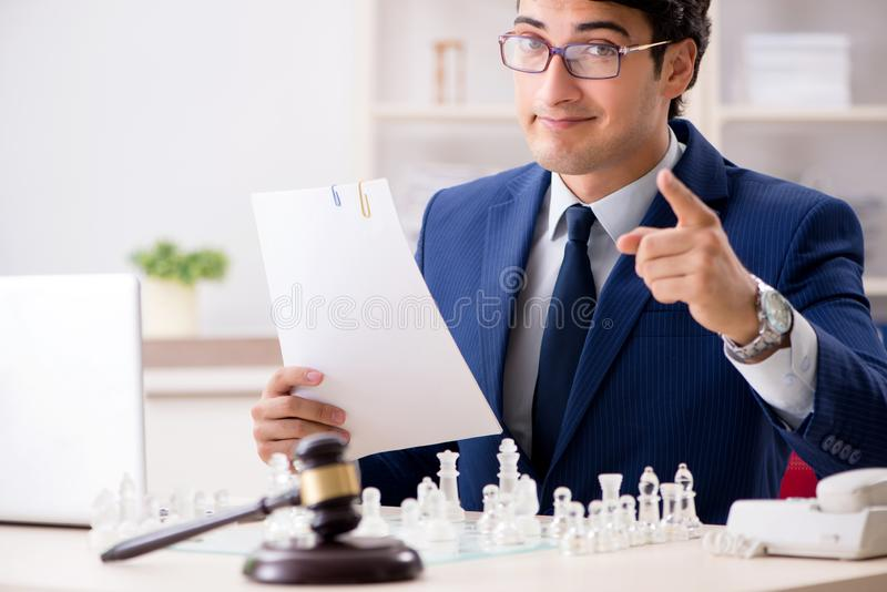 Young lawyer playing chess to train his court strategy and tacti. Cs royalty free stock photo