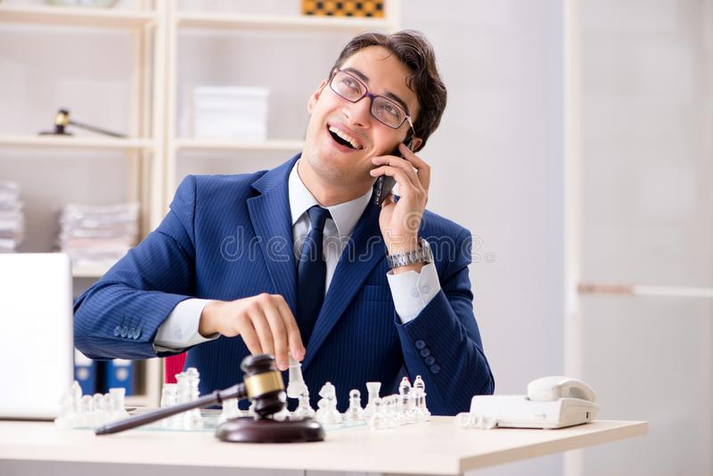 Young lawyer playing chess to train his court strategy and tacti. Cs stock image