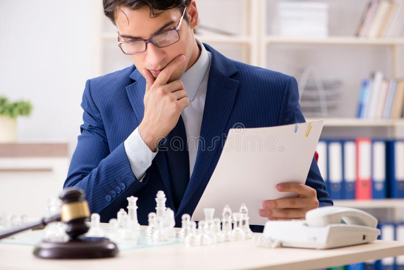 Young lawyer playing chess to train his court strategy and tacti. Cs stock images
