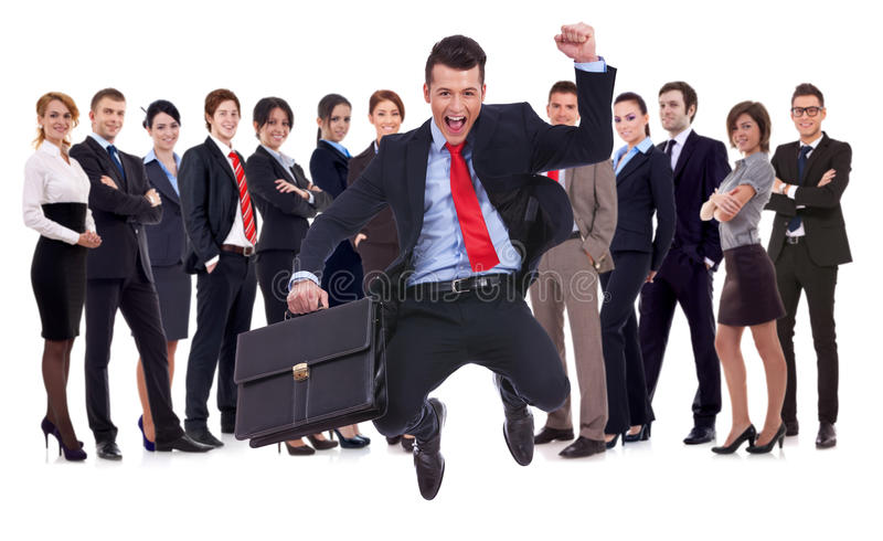 Download Young Leader Jumping For Joy In Front Of His Team Stock Image - Image: 26477959