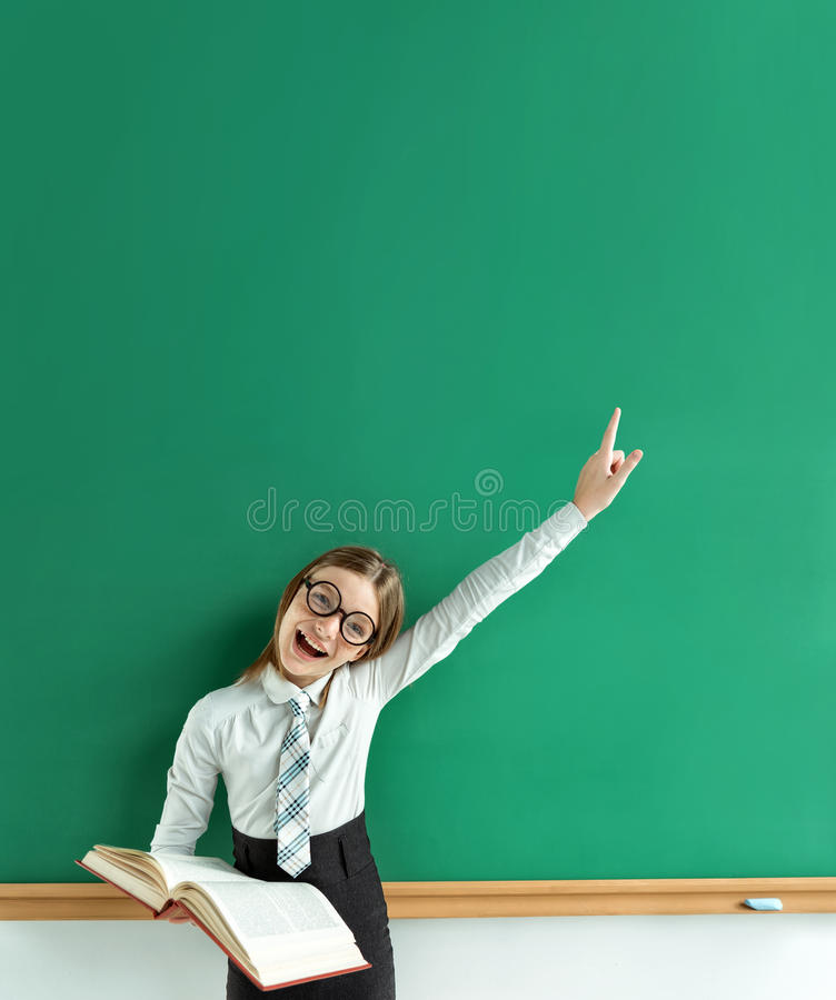 Young learner having good idea, pointing finger up. stock photography