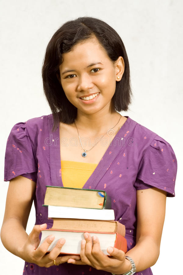 Download Young Librarian With Stack Of Literature Stock Photo - Image of ethnic, white: 13126660