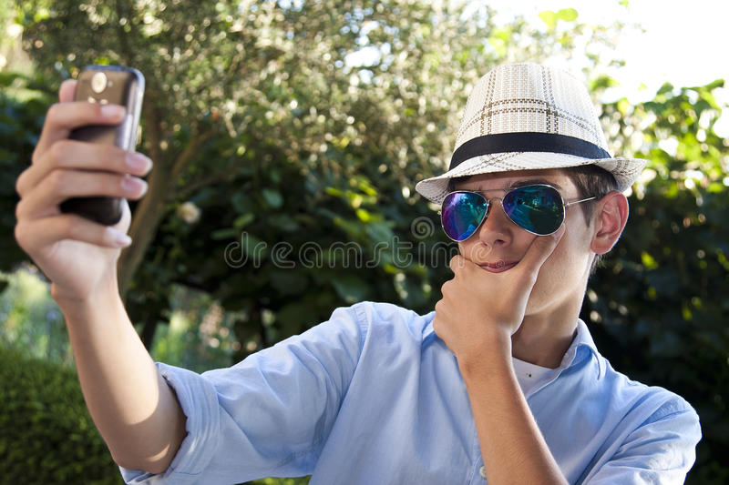 Young Life style. Young urban fashion outdoor camera with expressions, selfie royalty free stock image