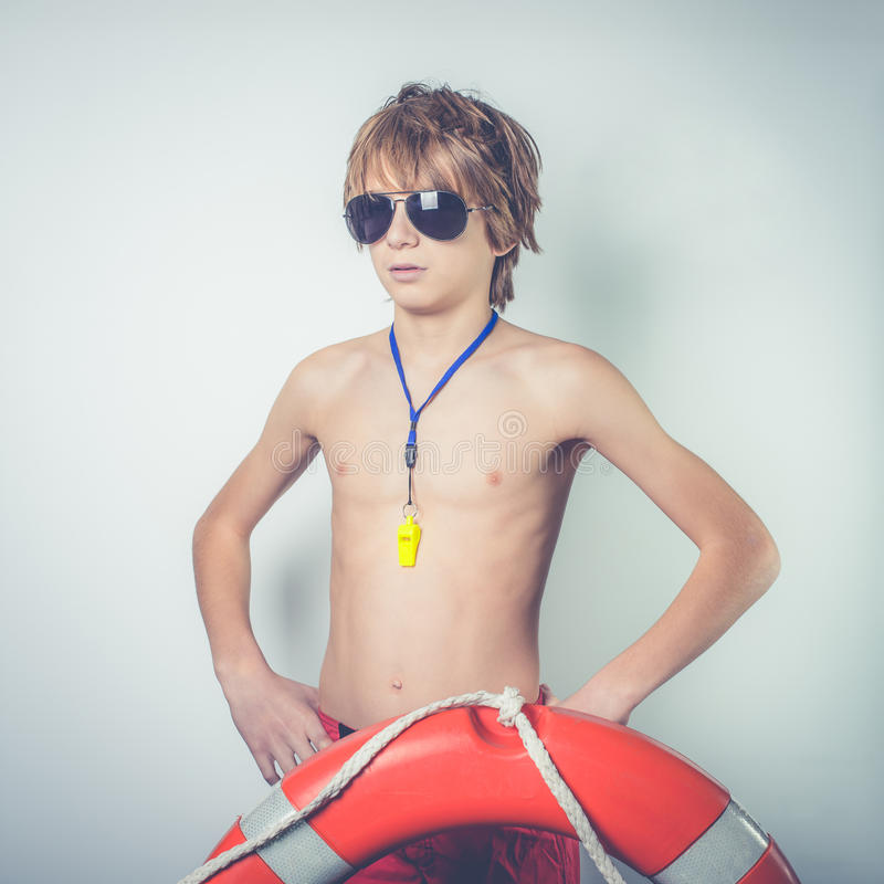 Young lifeguard. With lifebelt and whistle royalty free stock image