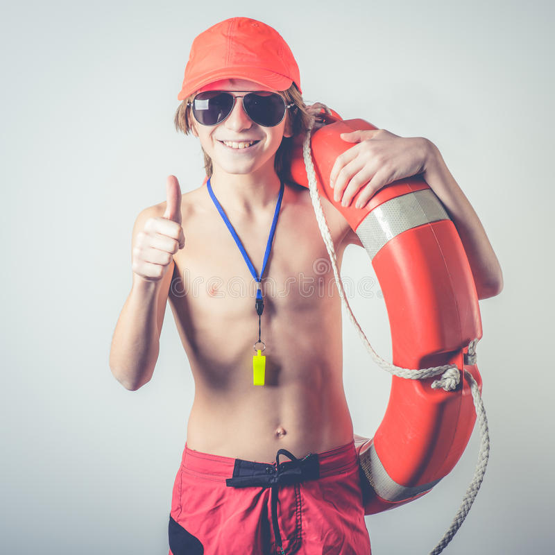 Young lifeguard. With lifebelt and whistle royalty free stock photography