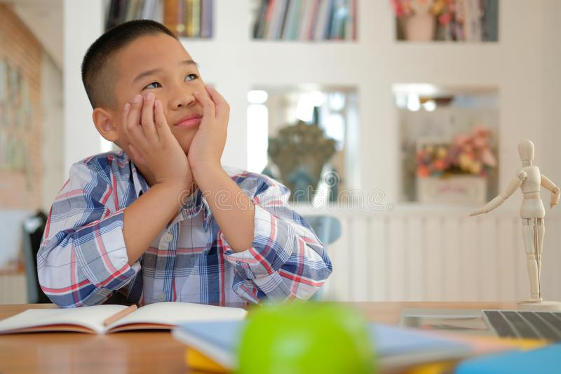 young little asian kid boy child children schoolboy thinking royalty free stock image