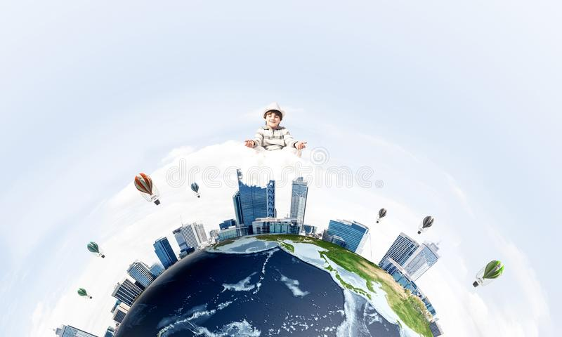 Young boy keeping mind conscious. Young little boy keeping eyes closed and looking concentrated while meditating on clouds in the air with panoramic view of stock illustration