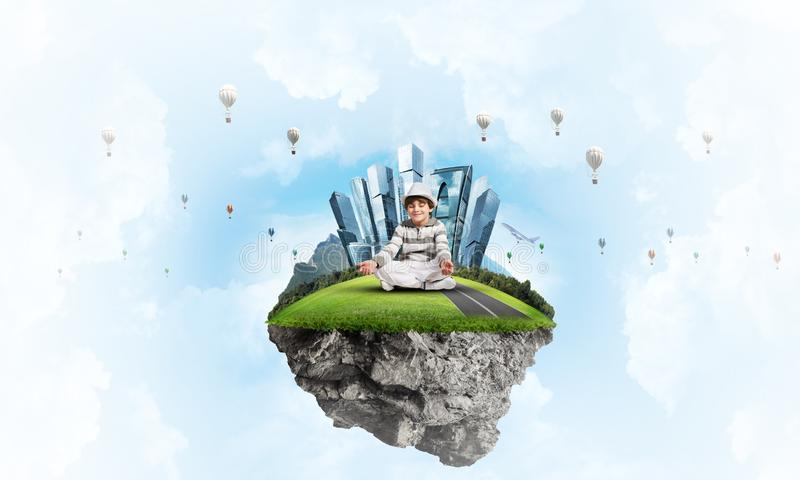 Little boy keeping mind conscious. Young little boy keeping eyes closed and looking concentrated while meditating on flying island in the air with cloudy royalty free illustration