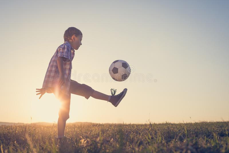 Young little boy playing in the field with soccer ball. Concept of sport royalty free stock images