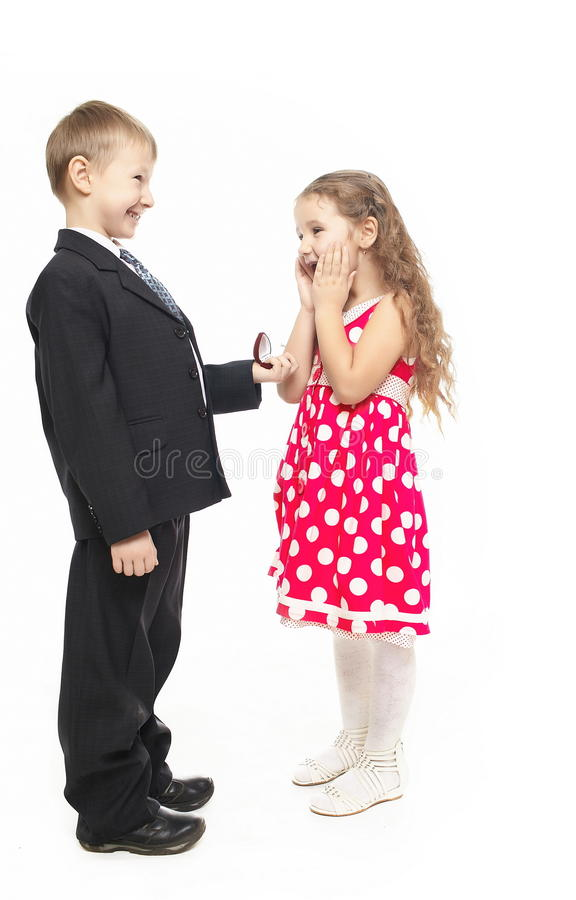 Young Little Boy Propose Marriage Surprised Girl Stock Photos