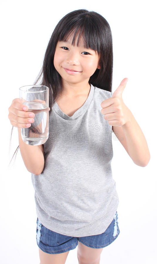 Young little girl drinking water. stock photos