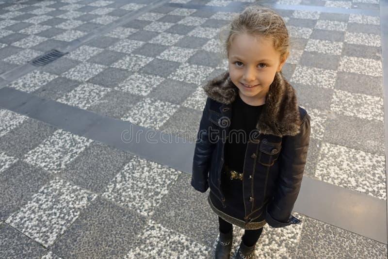 Young little girl posing in autumn stock photos