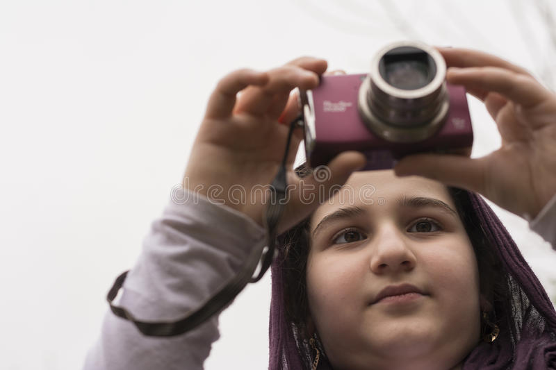 Young Little Girl Is Taking Photograph by Point and Shoot Camera. Young Little Girl Is Taking Photograph by Point and Shoot Digital Camera royalty free stock images