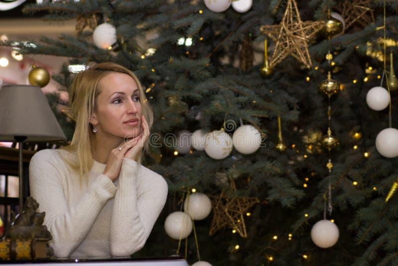 Young long hair girl celebration Christmas. Young blonde long hair girl celebration Christmas royalty free stock photo