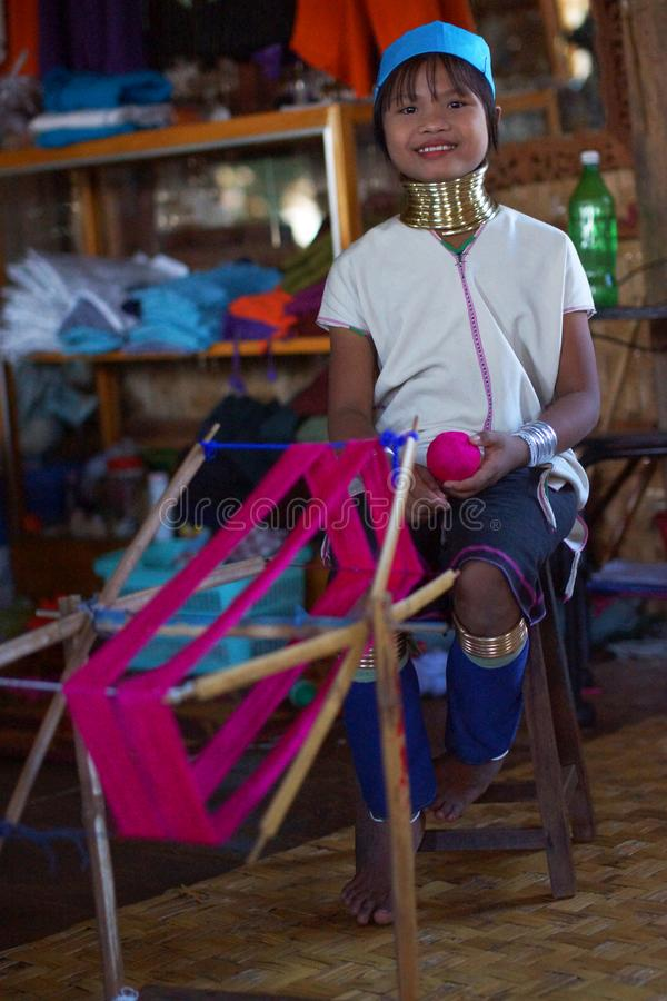 Long-necked woman handweaving in small fabric on Inle lake in Burma, Asia stock photography