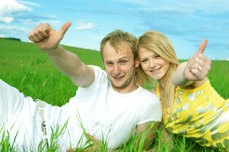 Young love couple smiling in field