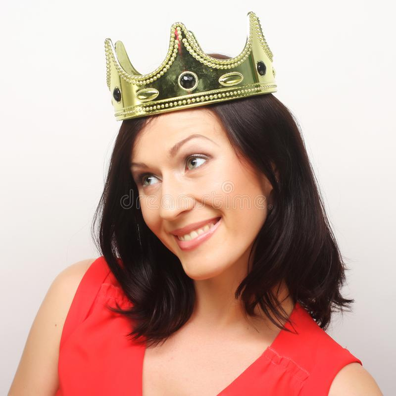 Young lovely woman in crown stock photography