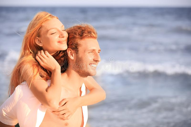 Young lovely couple on beach stock images