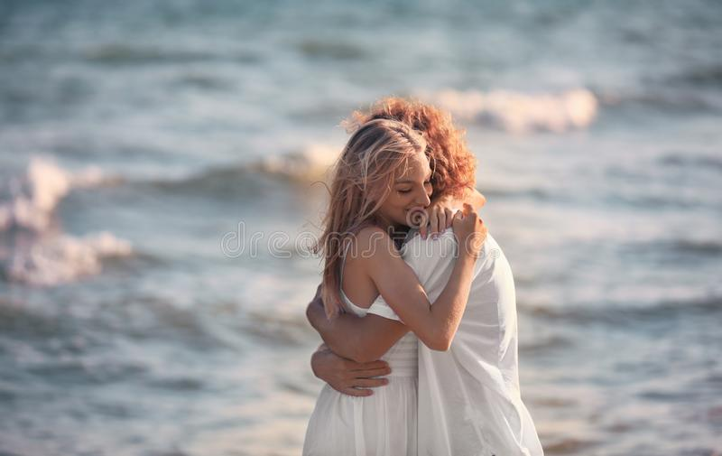 Young lovely couple on beach royalty free stock photography