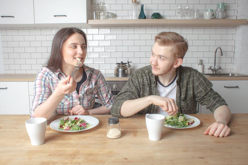 Young lovely couple has breakfast at kitchen stock photos