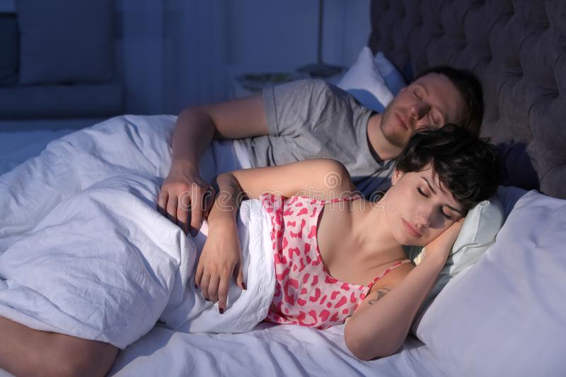 Young lovely couple sleeping in bed stock photo