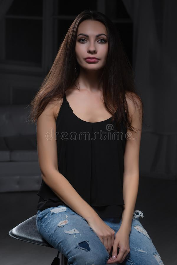 Young lovely lady posing in studio stock photo
