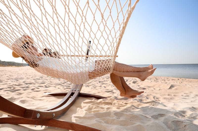 Young lovely relaxing in hammock royalty free stock image