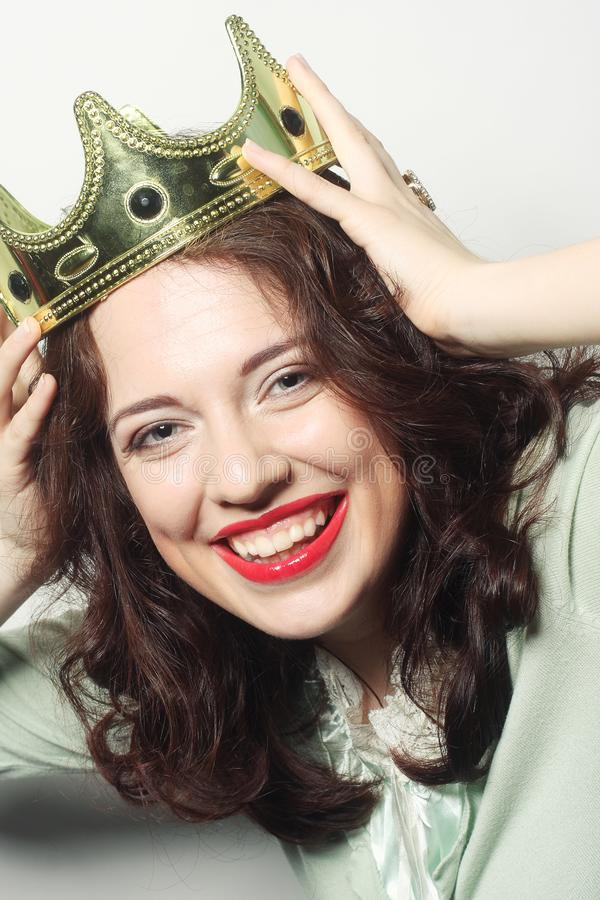 Woman in crown. Young lovely woman in crown stock images