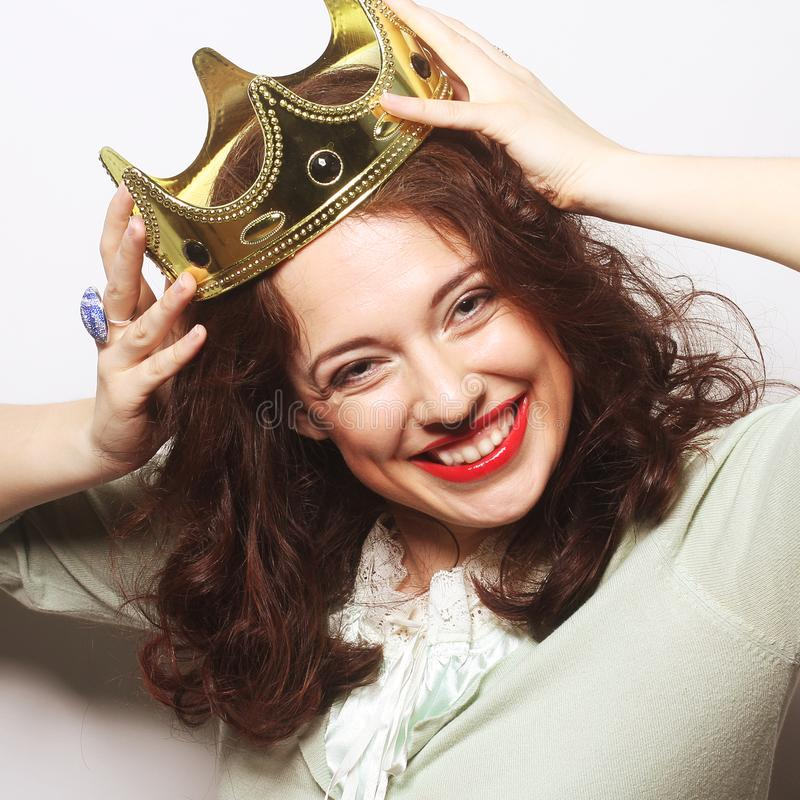 Woman in crown. Young lovely woman in crown royalty free stock image