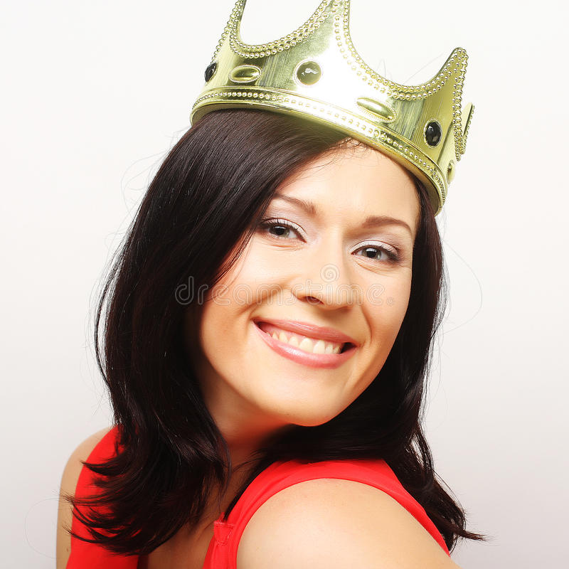 Young lovely woman in crown royalty free stock photography
