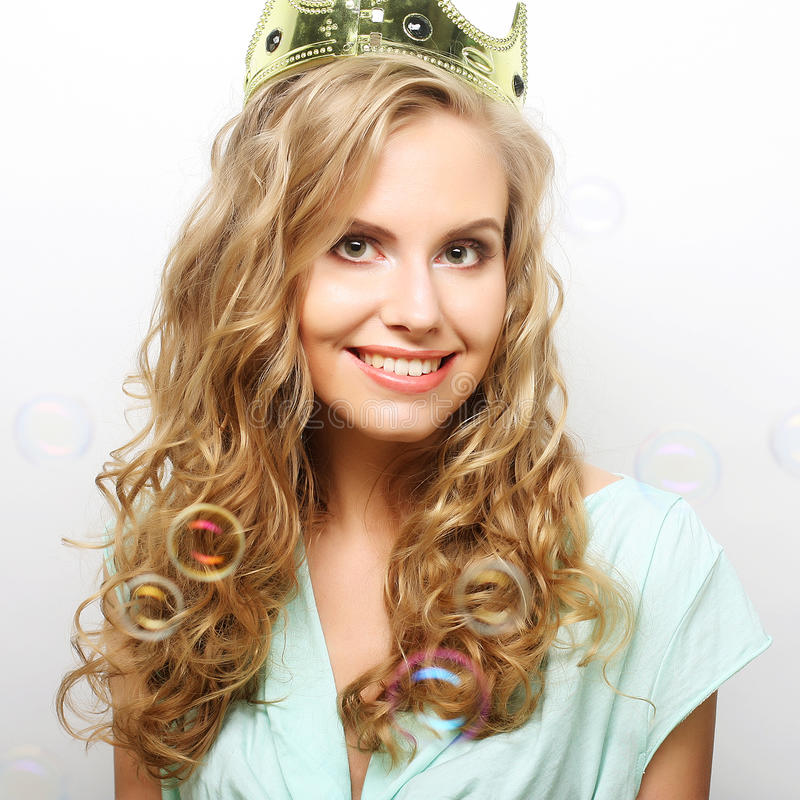 Young lovely woman in crown stock photos