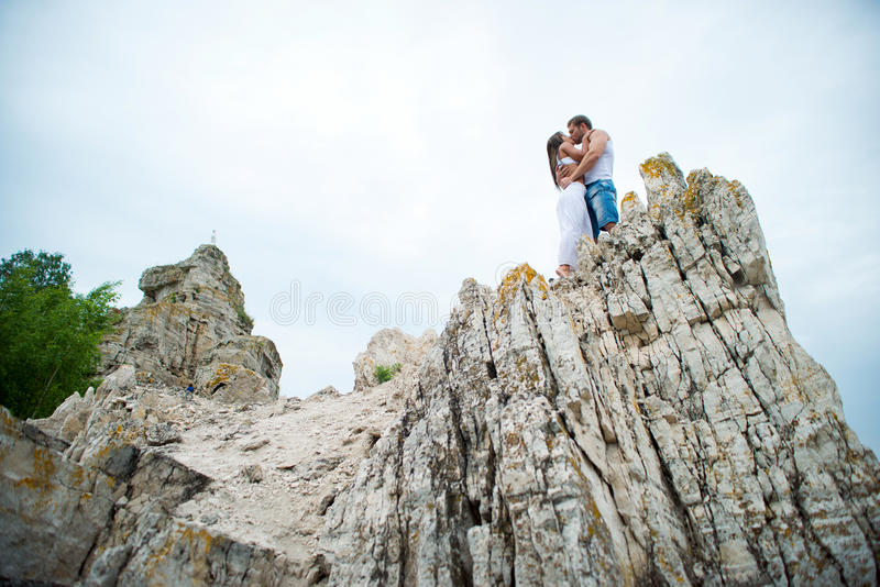 Young lovers man and woman walking in the mountains. Happy Young Couple lovers men and women walking in the mountains stock photos