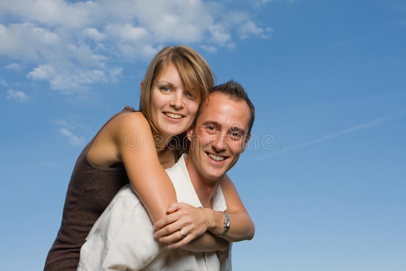 Download Young lovers piggy back stock image. Image of looking - 26970251