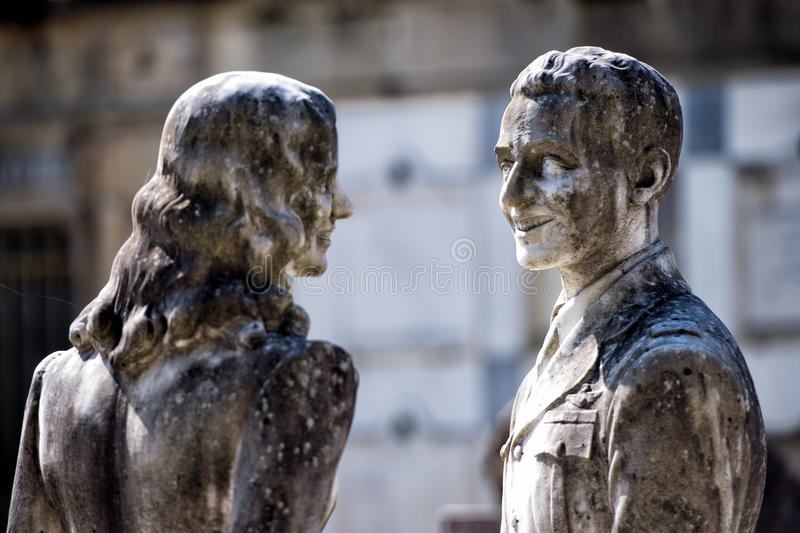 Young lovers while smiling marble statue royalty free stock images