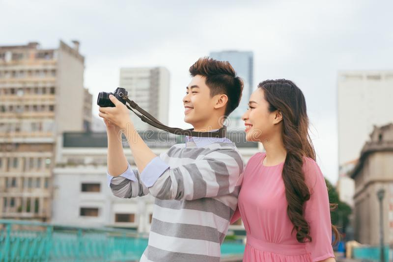 Young lovers walking around city on vacation, enjoying traveling royalty free stock images