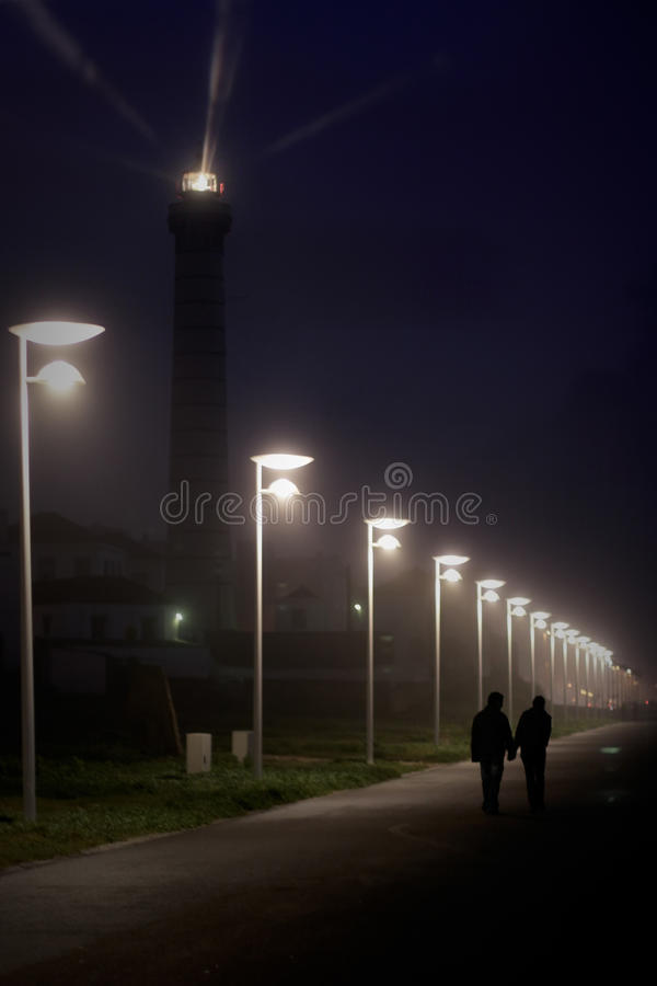 Young lovers walking at night stock photos