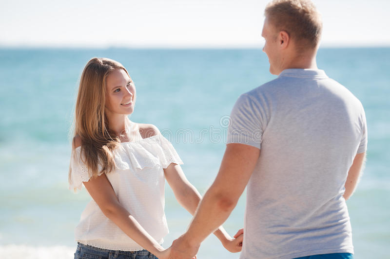 Young loving couple on the beach near the sea royalty free stock image