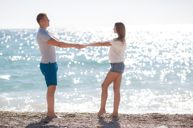 Young loving couple on the beach near the sea stock photo