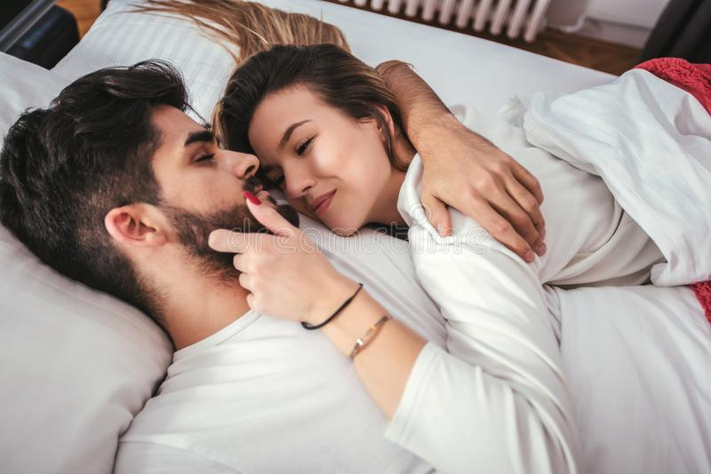 Young loving couple in the bed royalty free stock photo