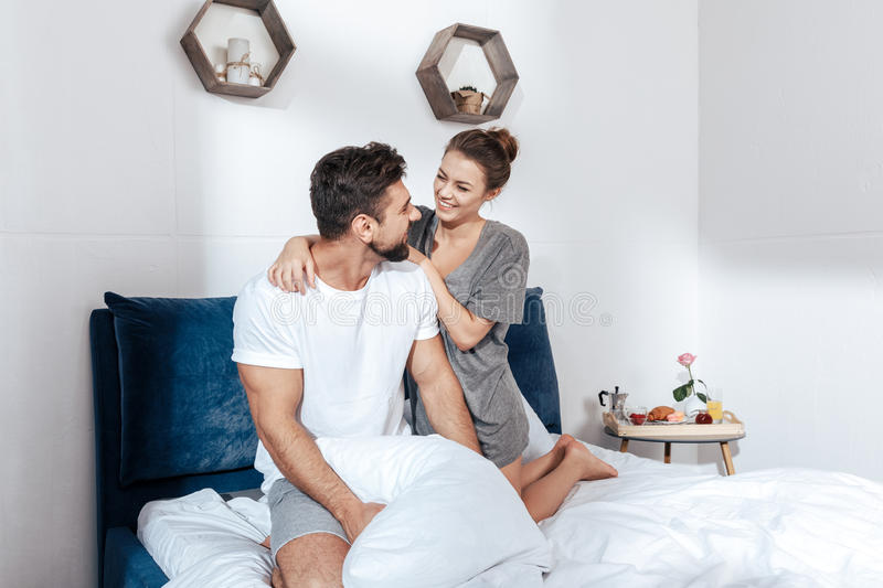 Young loving couple embrace in bed. Portrait of young loving couple embrace in bed stock photo