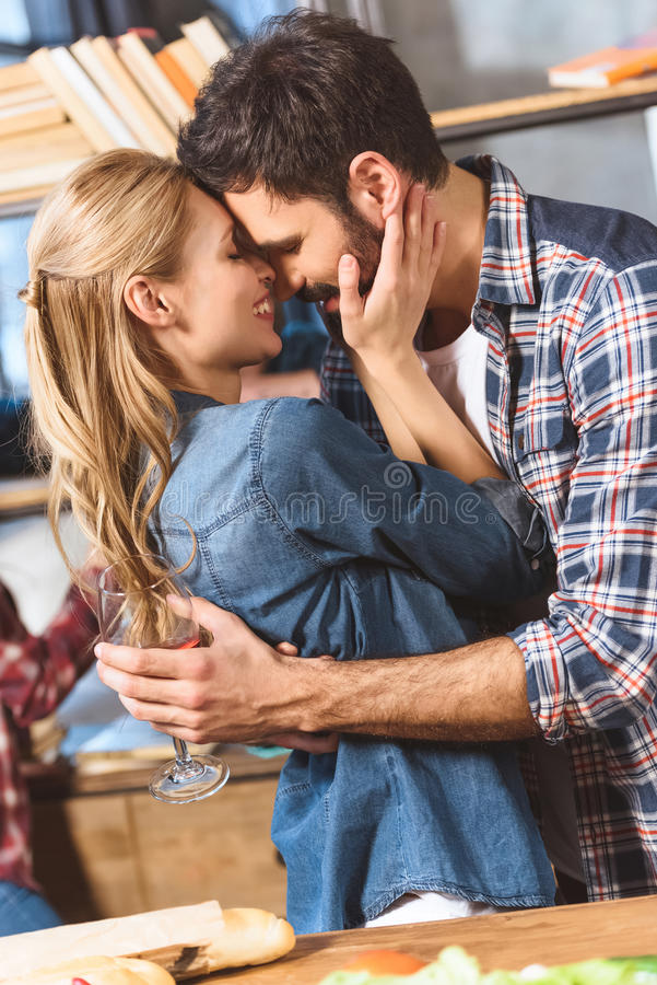 Young loving couple embrace and kissing. Close-up stock photo