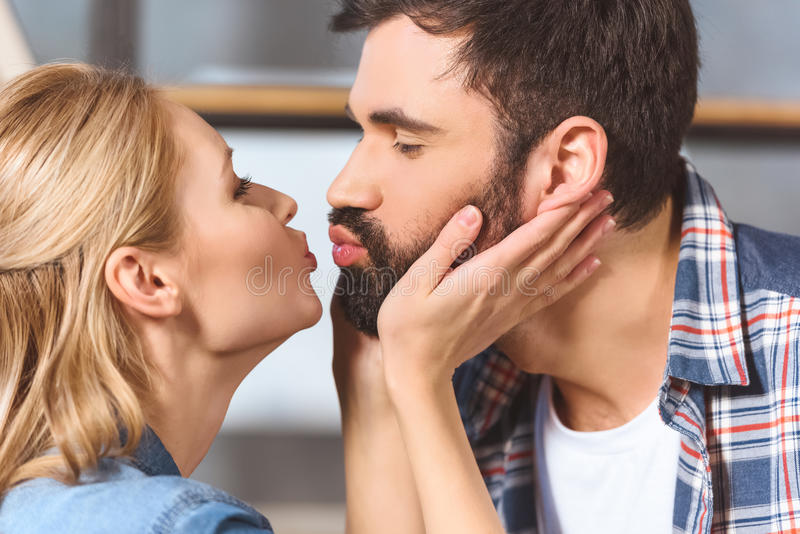 Young loving couple embrace and kissing. Close-up royalty free stock photography