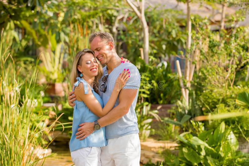 Young and loving couple embrace outdoors. In luxury resort stock photos
