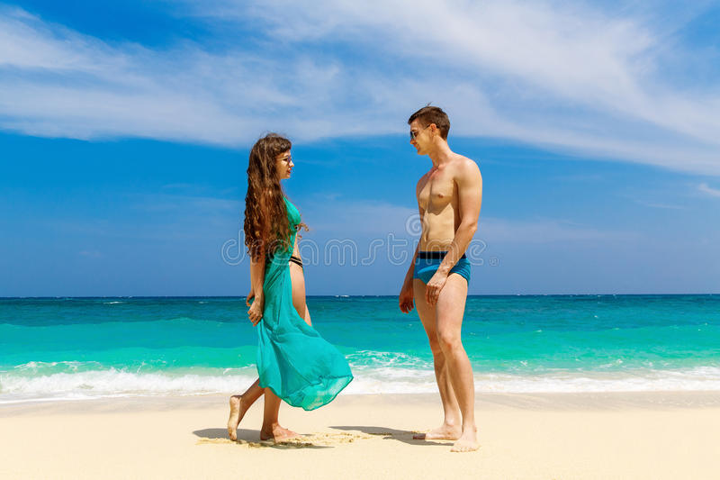 Young loving couple having fun on tropical beach. Summer vacation concept. royalty free stock photo