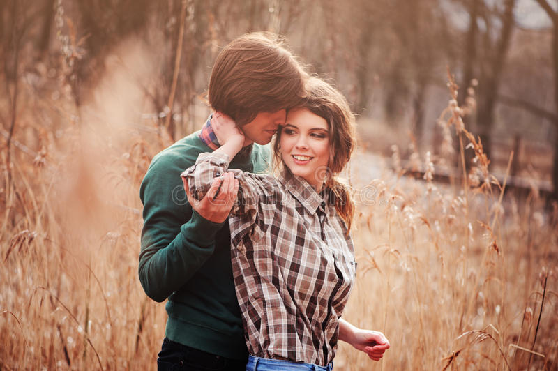Young loving couple having fun on the walk in country field stock photos