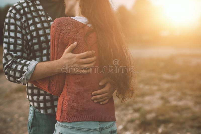 Young loving couple hugging outdoors stock photo