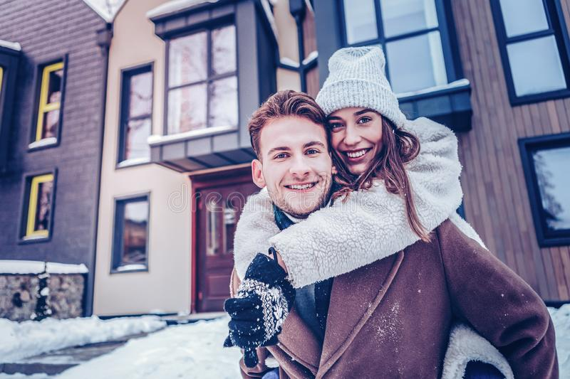 Young loving couple leaving their house in the morning royalty free stock images